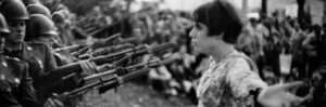Marc Riboud USA. Washington DC. 1967. An American young girl, Jan Rose KASMIR, confronts the American National Guard outside the Pentagon during the 1967 anti-Vietnam march.